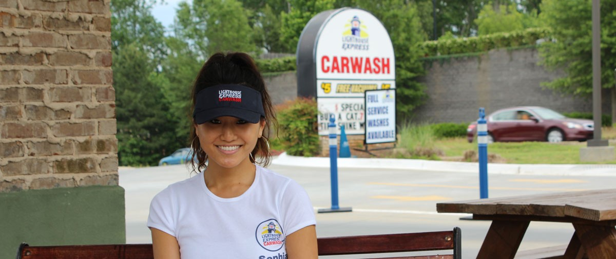 sophia relaxes after washing her car at lighthouse express car wash lawrenceville, ga