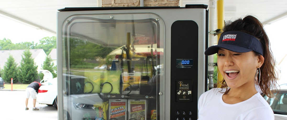 sophia models for guests in front of our car care vending machine